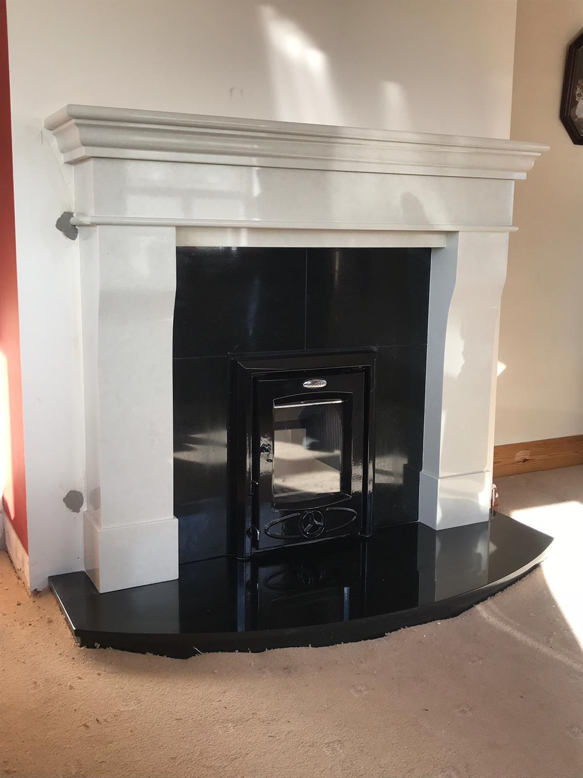 Lyonette fireplace with curved hearth